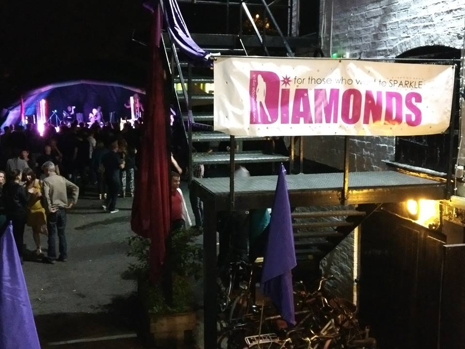 Diamonds banner with stage in background